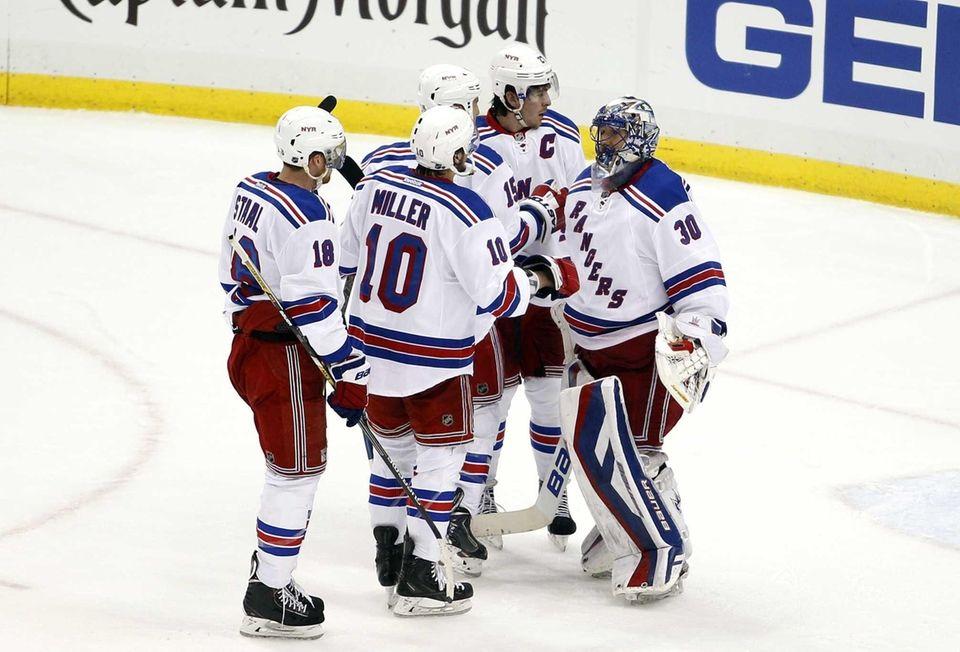 Ryan McDonagh #27 of the New York Rangers checks Phil Kessel #81 of the