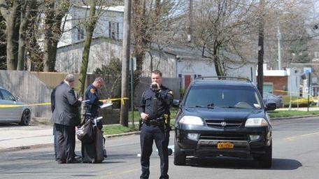 Police investigate the scene where a pedestrian was
