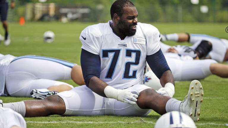 Tennessee Titans tackle Michael Oher warms up during