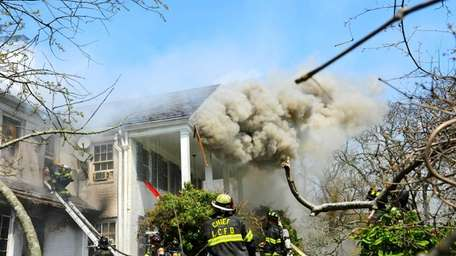 Multiple fire departments battled a house fire on