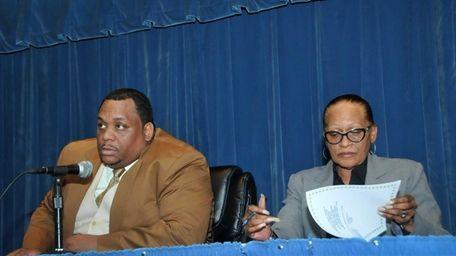 Hempstead school board president Lamont Johnson, left, with