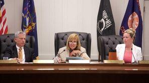 Islip Town Supervisor Angie Carpenter, center, speaks prior