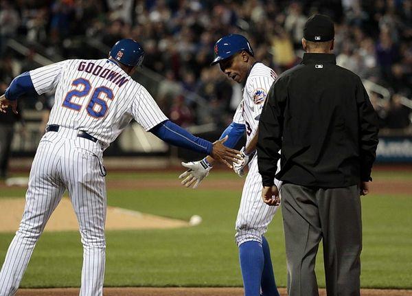 New York Mets rightfielder Curtis Granderson is congratulated