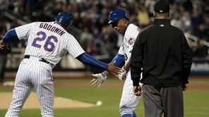 New York Mets rightfielder Curtis Granderson is congratulated