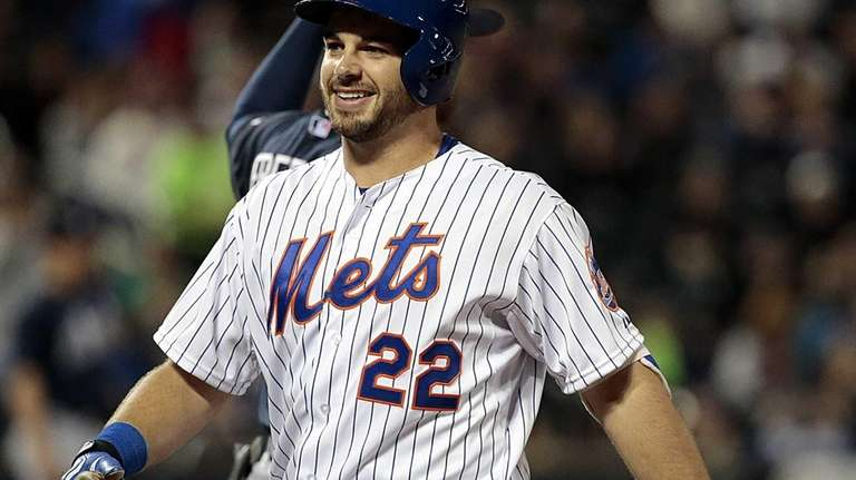 New York Mets catcher Kevin Plawecki reacts after