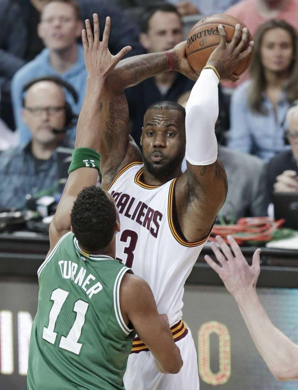 Cleveland Cavaliers' LeBron James looks to pass over