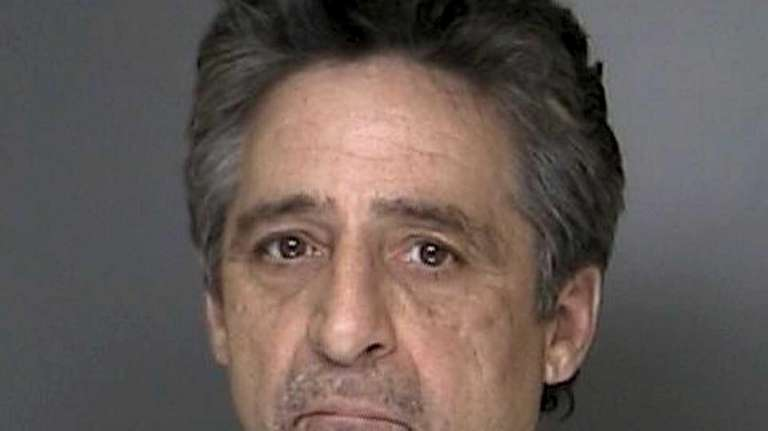 Police say William Mendolia, 55, of Mastic, robbed