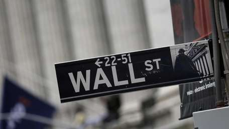 A Wall Street sign adjacent to the New