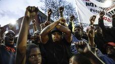 Protestors participate in a vigil for Freddie Gray