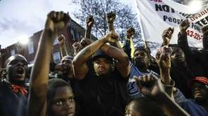 Protestors participate in a vigil for Freddie Gray