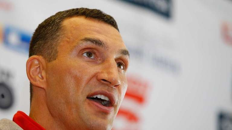Wladimir Klitschko speaks on the podium during the