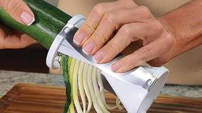 Veggetti spiral vegetable cutter cuts zucchini and other