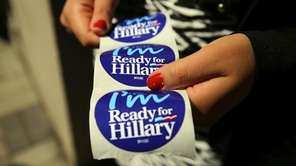 Stickers are handed out to supporters of Hillary