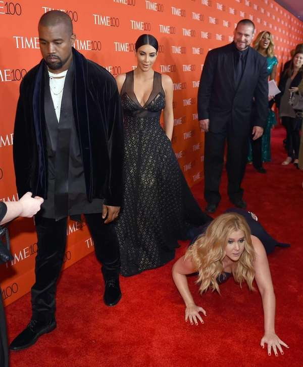 Honoree and comedian Amy Schumer pretends to trip
