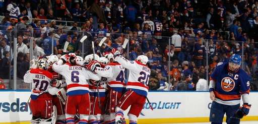 The Washington Capitals celebrate the game-winning overtime goal