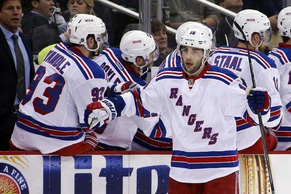 The New York Rangers' Derick Brassard (16) celebrates
