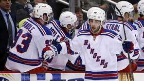 The New York Rangers' Derick Brassard (16) celebrates