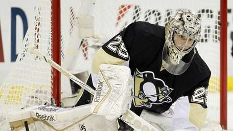 Marc-Andre Fleury #29 of the Pittsburgh Penguins covers