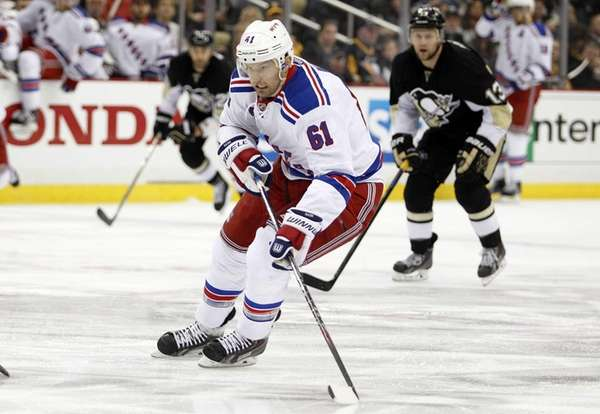 Rick Nash handles the puck during Game 4