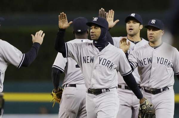 The New York Yankees celebrate their 13-4 win