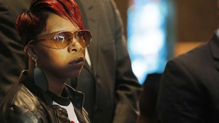 Lesley McSpadden, mother of Michael Brown Jr., listens
