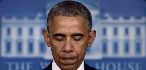 President Barack Obama pauses as he speaks in