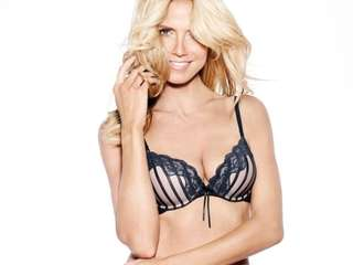 "Heidi Klum, the bombshell beautiful ""Project Runway"" host,"