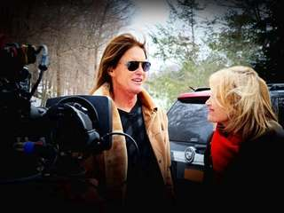 Bruce Jenner with Diane Sawyer in a shot