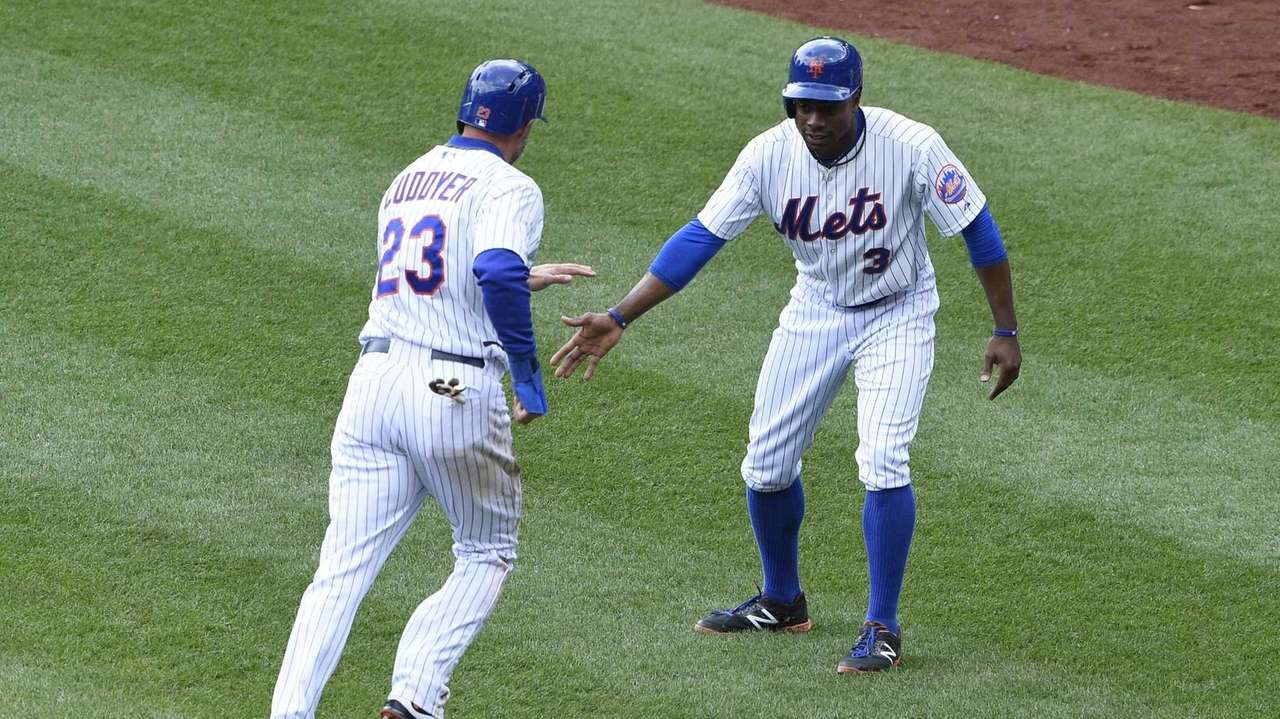 New York Mets rightfielder Curtis Granderson greets New