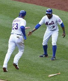 New York Mets rightfielder Curtis Granderson greets New