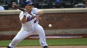 New York Mets starting pitcher Bartolo Colon hits