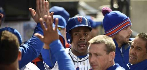 New York Mets rightfielder Curtis Granderson is greeted