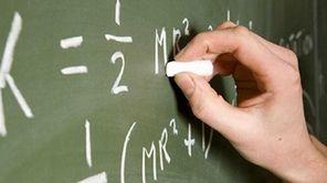 A teacher writing on a chalk board