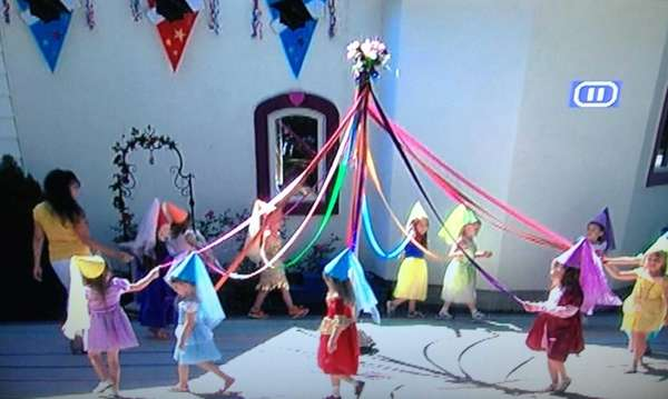 Kiddie Kollege preschoolers in Patchogue perform a maypole