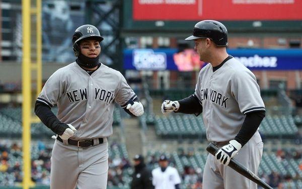 New York Yankees' Jacoby Ellsbury, left, is greeted