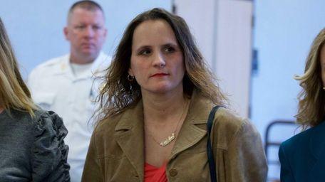 Christine Corelli leaves criminal court in Riverhead Thursday,