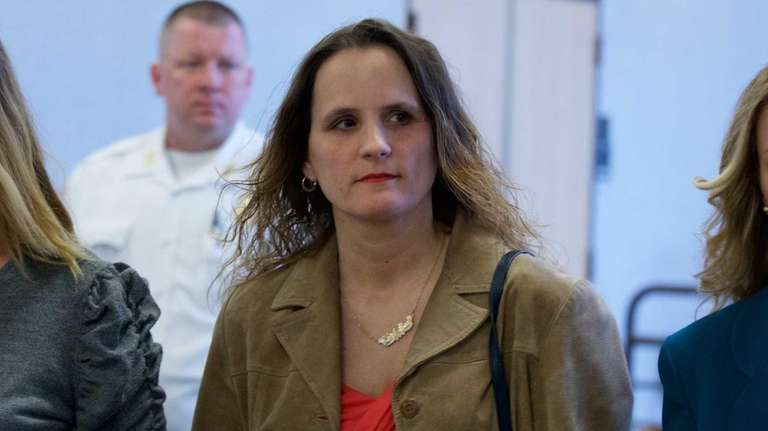 Christine Corelli leaves criminal court in Riverhead Thursday,