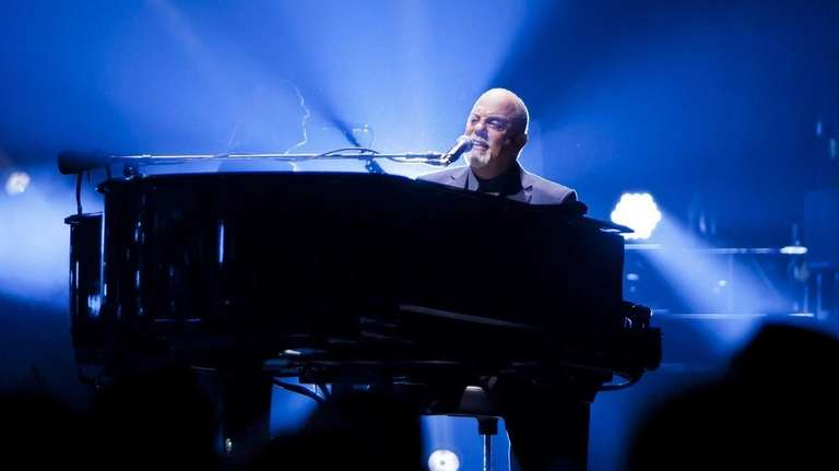 Billy Joel performs with his band at Madison