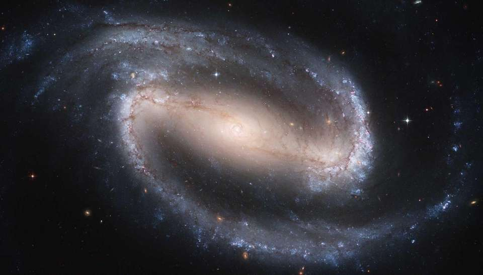 This image shows the barred spiral galaxy NGC