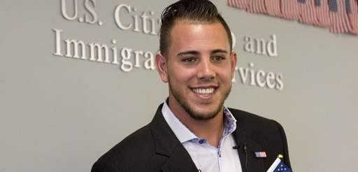 Marlins pitcher Jose Fernandez smiles after becoming a