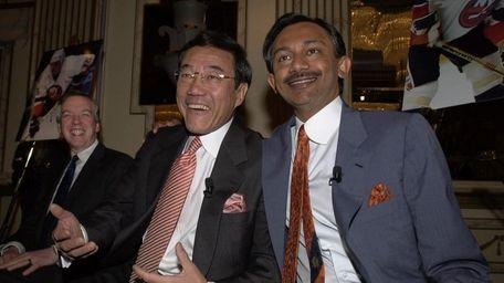 Software executives, Charles Wang and Sanjay Kumar, the