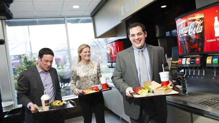 From left, franchisees Josh Kaufman, 35, of Huntington,