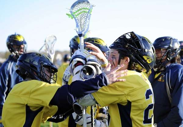 Massapequa attacker Ryan Tierney is congratulated by his