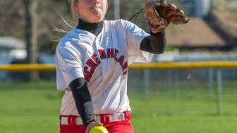 Sacred Heart pitcher Claire O'Brien throws against St.