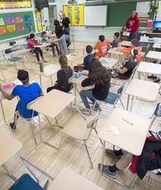 Amid empty desks, students at Southside Middle School