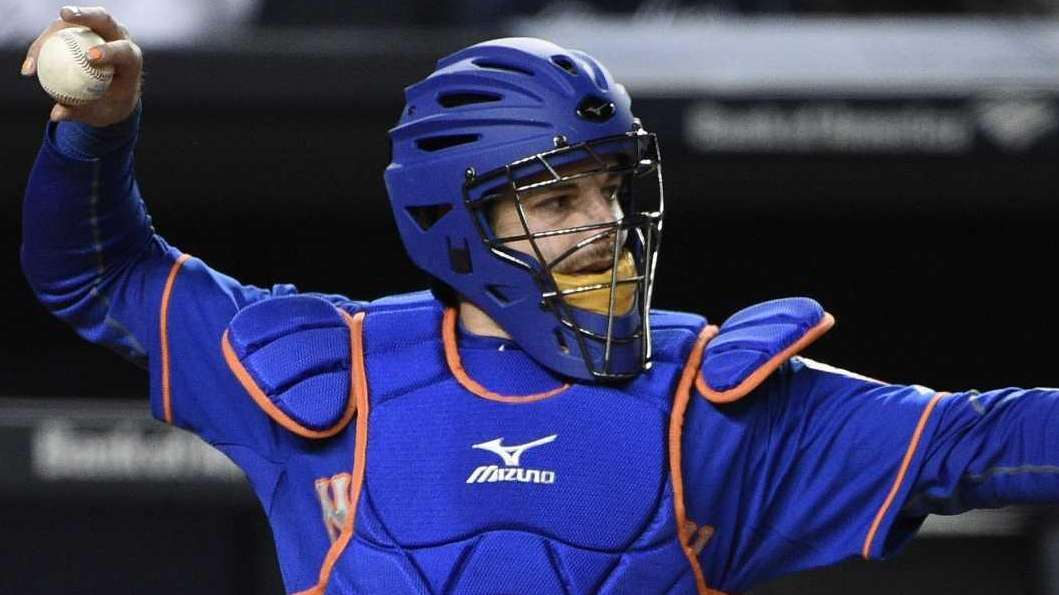 Mets catcher Kevin Plawecki warms up relief pitcher