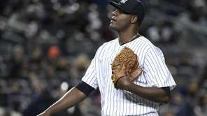 New York Yankees starting pitcher Michael Pineda walks