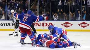 The New York Rangers celebrate their overtime goal