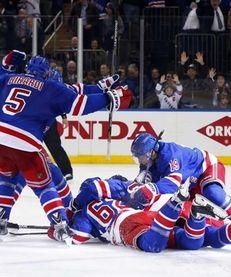 The New York Rangers celebrate their overtime goal