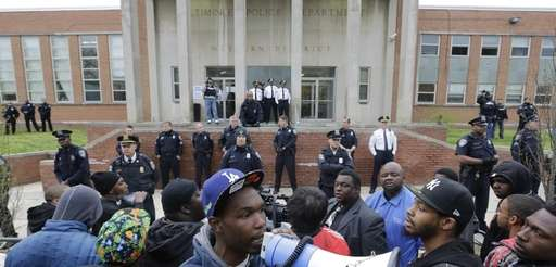 Protesters for Freddie Gray stand outside the Baltimore